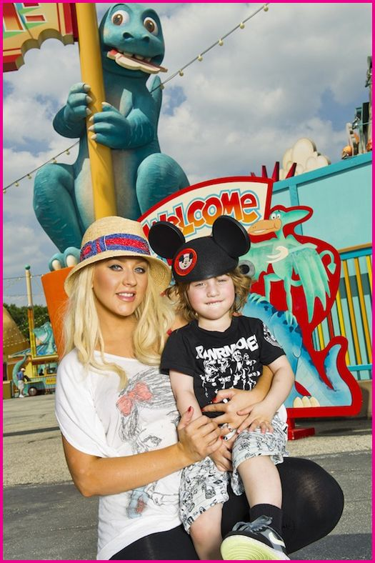 CHRISTINA AGUILERA AND HER SON MAX AT DISNEY WORLD IN FLORIDA - APRIL 11, 2011